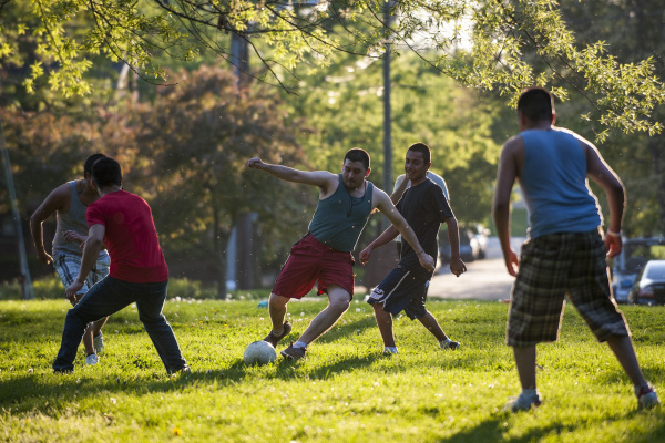 Geraldo Estrada, 24, of Columbus, controls the ball during a soccer game with friends in Goodale Park as the the sun casts long shadows late Wednesday afternoon, April 18, 2012. Warm weather and clear skies had Goodale Park full of people out enjoying the weather in the late afternoon. Forecasts call for an even warmer day Thursday with temperatures in the mid 70's.  (The Columbus Dispatch / Eamon Queeney)